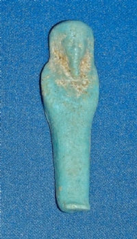 "A small but pleasant Ancient Egyptian turquoise glazed faience ""Ushabti"" figure. SOLD"